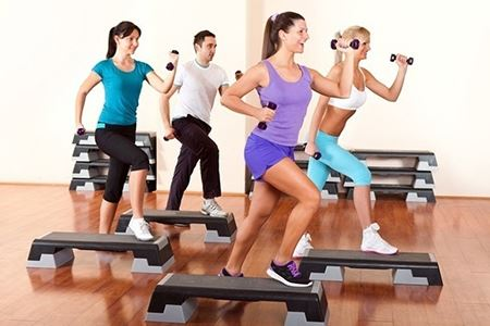 four people exercising